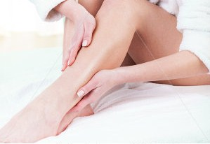 stock-photo-woman-rubbing-lotion-on-her-legs-after-depilation-186085064